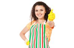 Young housewife with cleaning gloves Stock Photos
