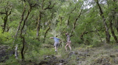 Couple Climb Uphill To Get A Good View Stock Footage