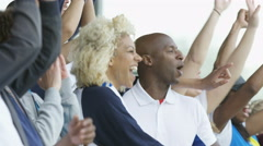 4K Crowd of spectators cheering at sports event, woman holding British flag Stock Footage