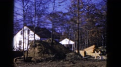 1954: construction in the woods HICKSVILLE, NEW YORK Stock Footage