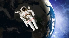 Astronaut in open space in front of earth Stock Footage
