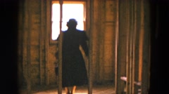 1954: woman and child walking in unfinished house looking out window HICKSVILLE Stock Footage