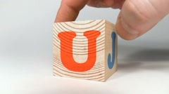 Wooden cube with the letters Stock Footage