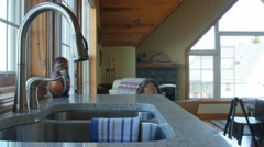 Dolly shot of a kitchen sink in a beautiful home Stock Footage