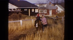 1954: the mother and son take a nice stroll along the farm HICKSVILLE, NEW YORK Stock Footage