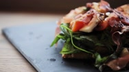 Prosciutto ham salad on stone plate at restaurant Stock Footage