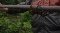 Tarantula broom handle holding Stock Footage