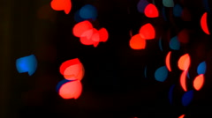 Colorful abstract shiny sparkles on dark blurred background Stock Footage