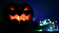 Closeup of scary holiday halloween carved glowing pumpkins. Flashing colored Stock Footage