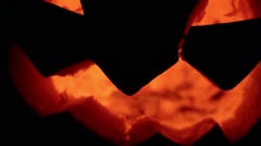 Closeup of scary holiday halloween carved glowing pumpkins. Jack-O-Lantern on Stock Footage