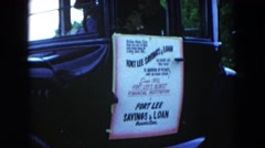 1954: antique car door is a sign for fort lee savings & loan HICKSVILLE, NEW Stock Footage