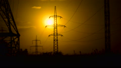 Power lines in the setting sun Stock Footage