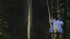 Escaped patient disappears into woods Stock Footage