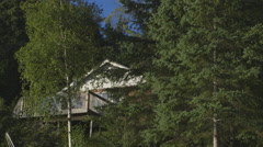 Pan up to Cabin in Woods Stock Footage