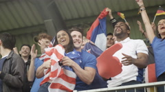 4K Crowd of spectators cheering at sports event with flags of many nations Arkistovideo