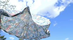 Flowery table parasol opens Stock Footage
