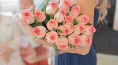 Woam hold rose bouquet Stock Footage