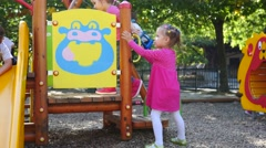 Active kids have fun playing on outdoors playground for children Sofia Bulgaria Stock Footage