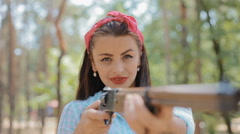 Pin up woman hold gun in her hands Stock Footage