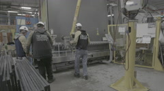 Workers together in glass factory working Stock Footage