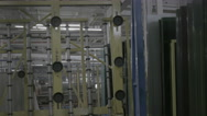 Glass factory machines working - industrial scene Stock Footage