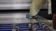 Close up hands in glass factory working on pane Stock Footage