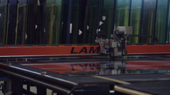 Glass manufacturing machines in factory Stock Footage