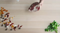 Top View of Chefs Hands Cutting Beaf. Raw Meat Slices Chopped On Wooden Board Stock Footage