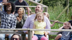 4K Families watching a demonstration at falconry center, focus on audience Stock Footage