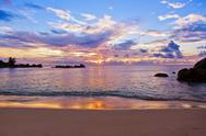 Seychelles tropical beach at sunset Stock Photos