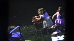 1954: kids playing pushing rope swinging dressed HICKSVILLE, NEW YORK Stock Footage