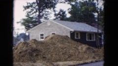 1954: view of houses and new construction in a wooded neighborhood HICKSVILLE Stock Footage