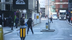 Office workers crossing the road in London Stock Footage