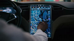 Man explore the map at dashboard in electric car Stock Footage