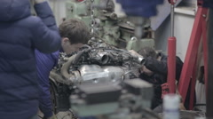 Workers inspect the car engine Stock Footage