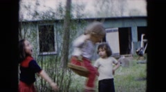 1955: three little girls play outdoor on a swing attached to a tree HICKSVILLE Stock Footage