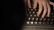 Girl typing on an old typewriter Stock Footage