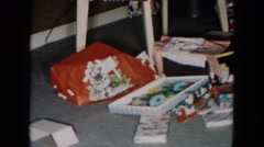1955: gift building with family on floor surrounded by many opened boxes Stock Footage