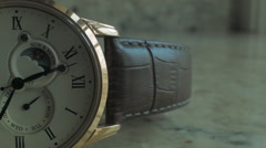Close up of a half faced Wrist Watch with second hand against light background Stock Footage