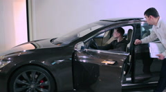 Man test the sunroof in electric car Stock Footage