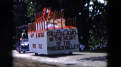 1955: a large pascack valley float traveling up the street in a town parade Stock Footage