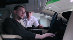 Man testing the dashboard inside the electric car Stock Footage