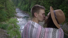 Couple Kiss And Hug, Wrapped In Blanket, They Look Out At Amazing River View Stock Footage