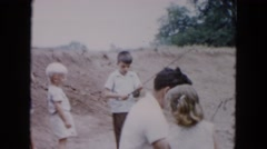 1955: a father teaching his little daughter how to fish for the first time Stock Footage