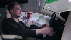 Young man test the electric car Stock Footage