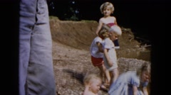 1955: various young children playing in the mud on the water's edge HICKSVILLE Stock Footage