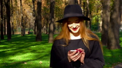 Young fashionable girl with red lips using smartphone Stock Footage