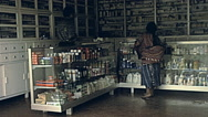 Guatemala 1982: woman in a Pharmacy Stock Footage