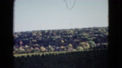 1958: a hilly remote green landscape with structures under a blue sky NEVADA Stock Footage