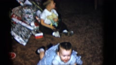 1958: cute girl dress lie down toddler NEVADA Stock Footage